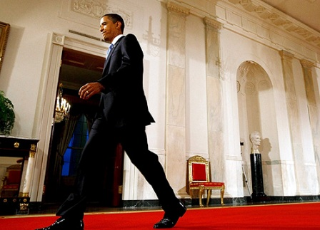 President Obama Strides Into The East Room Of The White House For The News Conference
