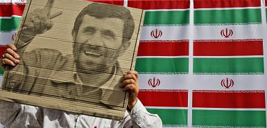An Ahmedinejad Supporter Waves A Poster At A Rally